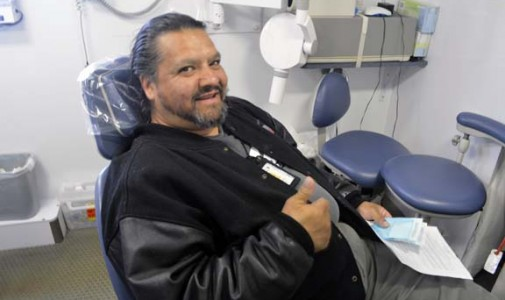 """That's the best thing about this job—watching people leave happy,"" says Omar Abarca, dental assistant and driver."