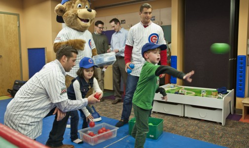 The Chicago Cubs' new mascot, Clark, and prospects Mike Olt and Albert Almora play a ball toss game with the kids.