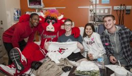 Chicago Bulls players and Benny the Bull brighten young spirits